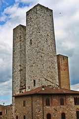 Highest towers in old town (Emanuele Barcali) Tags: vacation sky italy sun black green tower love clouds countryside photo san artist view gimignano weekend withe sunny medieval hills tuscany sangimignano castello borgo castel torri blackwithe togheter