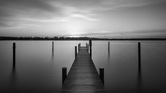 Monochromatic Landing Stage (photovojac) Tags: longexposure sunset sky blackandwhite bw lake berlin beach nature water monochrome clouds strand river landscape see pier wasser sundown himmel fluss grunewald steg landingstage havel wannsee grunewaldturm neutraldensityfilter graufilter nd110