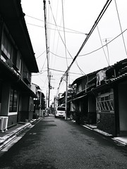 () Tags: sky cloud white black building japan architecture way point outdoors town kyoto long day power empty snapshot perspective cable structure line   vanishing residential narrow  forward diminishing supply iphone
