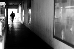 Behind the girl with the umbrella (pascalcolin1) Tags: blackandwhite reflection girl rain umbrella mirror noiretblanc pluie miroir reflets streetview parapluie paris13 fillette photoderue photopascalcolin