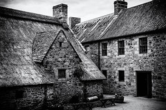 Beautiful Hamptonne (MacBeales) Tags: black white building jersey hamptonne canon eos stone window door museum nik silver efex