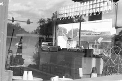 For Rent (Wayman P. Jones) Tags: blackandwhite reflection abandoned monochrome downtown dof streetphotography trix400 olympus35sp kodaktrix400