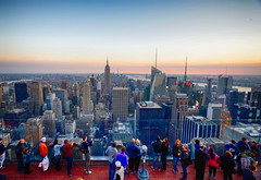Top of the Rock in New York (` Toshio ') Tags: city newyorkcity sunset people newyork america cityscape manhattan rockefellercenter tourists midtown empirestatebuilding topoftherock observationdeck toshio freedomtower xe2 oneworldtradecenter fujixe2
