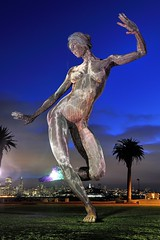 """Bliss Dance"" - Treasure Island, San Francisco (Joao Eduardo Figueiredo) Tags: sanfrancisco california sculpture woman usa colour sexy art skyline female naked nude lights twilight nikon treasureisland arts baybridge bluehour greatlawn marcocochrane joaofigueiredo nikond3x blissdance avenueofpalms joaoeduardofigueiredo"