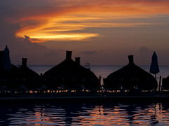 Parasols (MomoFotografi) Tags: sunset sea vacation sky color beach water pool night digital landscape mexico boats island hotel evening shadows resort cozumel paysage soir nuit plage zuiko parasols zd 1454mm occidentalgrandcozumel olympuse5