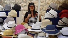 I have a hat for you! (halifaxlight) Tags: street woman display hats croatia sunny dubrovnik seller oldcity ilovemypics