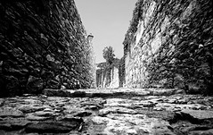 Down low (NikNak Allen) Tags: street white black stones bricks cobble lane walls spain2013