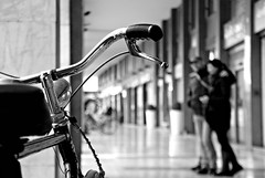 untitled (padova, italy) (bloodybee) Tags: street people bw italy bike bicycle couple europe downtown bokeh porch padova padua 365project corsomilano