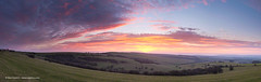 Sussex Sunrise Panorama (Nick Dautlich) Tags: pink england panorama sun clouds sunrise sussex countryside scenery colours britain pano hills landscapeuk
