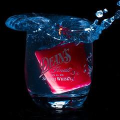 """Feuerwasser"" (laurin.gutwin) Tags: rot water glass wasser candle whiskey kerze flame whisky scotch blau flamme schwarz glas spritzer"