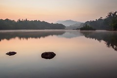 Serene rocks (Picsnapr) Tags: india reflection nature water sunrise river landscape rocks pebbles slowshutter gokarna karnataka noclouds aghanashini