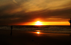 IMG_0340 (pinktigger) Tags: sunset sea man holland netherlands dutch silhouette scheveningen nederland northsea seashore wawes