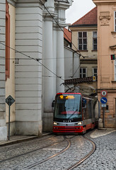 Prague Jan 2015 (6) 038 - Tram passing through a tight arch in the Little Quarter (Mark Schofield @ JB Schofield) Tags: santa city bridge streets tower castle church architecture gold casa europe track break republic czech prague little bell interior transport paintings murals tram chapel charles praha ceiling stnicholas quarter cloister marble baroque pillars bloc cobbles domes eastern loreto tatra loreta