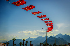 Windy (Melissa Maples) Tags: blue trees summer mountains turkey nikon asia trkiye flags palmtrees antalya lensflare flare nikkor vr afs  sunflare 18200mm  f3556g  18200mmf3556g turkishflags d5100