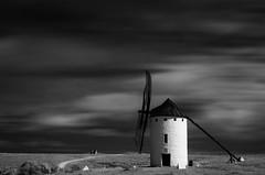 Campo Criptana (Ral Villaln) Tags: campocriptana lamancha spain mills donquijote sky blackandwhite clouds longexposure infrared ir filter hoyar72 landscape spanish wind nikond5100 raulvillalon