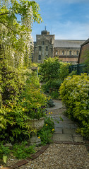 The tiny but exquisite  town garden of No. 4 Mill Lane in Romsey, Hampshire is just 120 ft long and very narrow. It has this view over 10th century Romsey Abbey. (Anguskirk) Tags: uk england eu hampshire tiny gb narrow ngs romsey nationalgardensscheme romseyabbey towngarden 4milllane