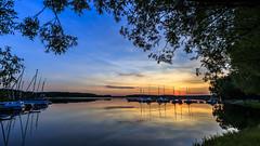 Sunset (Akito-X) Tags: blue sunset water colors yellow de boats bayern deutschland bavaria mirror wasser ast branch sonnenuntergang boote gelb blau spiegelung hdr farben canonefs1022mmf3545usm hilpoltstein rothsee canoneos7dmarkii