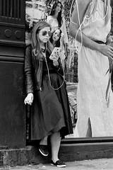 The Curious Poster Girl (CVerwaal) Tags: nyc girls blackandwhite usa ny newyork mural streetphotography cellphones olympusem5 mzuiko25mmf18