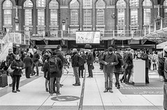 Concourse congregation (Nodding Pig) Tags: london film monochrome station 35mm railway scan passengers hp5 ilford nikonfm2 liverpoolstreet concourse nikkor50mm 20151227032101