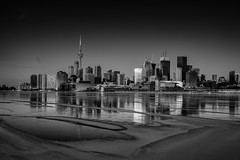 Frozen City (Dan Fleury) Tags: winter white lake toronto ontario canada black cold tower water skyline cn frozen cityscape shore bnw yyz 416 polson cans2s