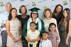 Commencement 2016 (uoeducation) Tags: family friends portrait college lights parents university diploma stage aaron group graduation ceremony celebration uo backdrop lit graduate montoya coe uofo universityoforegon grads uoregon gather collegeofeducation commencment matthewknightarena uocoe fwicomm16 coebackdrop
