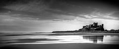 Bamburgh Castle (Alan Hinchliffe) Tags: uk blackandwhite bw castle monochrome canon landscape mono pano fineart scenic panoramic 7d bamburgh nothumberland