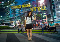 North korean teen defector in front of a gangnam style logo, National capital area, Seoul, South korea (Eric Lafforgue) Tags: city urban streets horizontal night buildings advertising asian outdoors lights town colorful asia neon place outdoor refugee capital sightseeing korea location seoul colourful southkorea youngadult interest metropolitan psy gangnam fourpeople 4people defector lookingatcamera northkorean nationalcapitalarea colourpicture sk162381