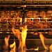 Baskets of chicken wings are a blur as they rotate past the flames of Fahrenheit's rotisserie in the newly opened University Dining eating establishment, On The Oval, on Centennial Campus.