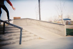 Boardslide (Scisssorhands) Tags: plaza fall film weather 35mm holga angle skateboarding board idaho skatepark skate skateboard boardslide skateboarder caldwell styel