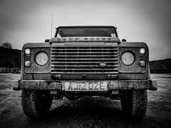 The rover (joeivory) Tags: uk greatbritain england blackandwhite car mood mud offroad 4x4 perspective automotive olympus grill dirt vehicle landrover quarry dram hardworking frontgrill headllights omdem5 vision:text=0752 vision:ocean=0564