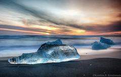 New Years Ice (Kristinn R.) Tags: sea sky sun ice clouds blacksand iceland nikon jkulsrln nikonphotography d700 breiamerkursandur nikond700 kristinnr