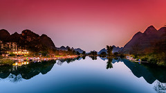 Colors of Serenity (Santo(Thanks for 2 Million++views!!)) Tags: china longexposure blue sunset shadow sky mountains reflection colors stone night clouds river dark landscape boat colorful asia village nightscape natural outdoor guilin yangshuo environmental hills scenary d800 riverli originalphotography mygearandme mygearandmepremium mygearandmeplatinum