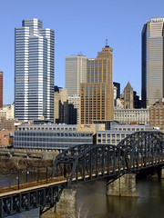 (Shane Henderson) Tags: old bridge trees winter black water leaves sign skyline architecture buildings river logo downtown pittsburgh shadows skyscrapers steel branches huntington bricks traintracks stained cables wires worn weathered railroadbridge distressed beams railroadtracks supports pnc monongahelariver citycountybuilding uniontrustbuilding alleghenycountycourthouse panhandlebridge citizensbanktower grantbuilding oneoxfordcentre regionalenterprisetower bridgepiers onemelloncenter pncfirstsidecenter bnymelloncenter 525williampennplace robincivicbuilding 2melloncenter