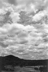 mpix 55 061016 N80 28mm R60 BW400CN 061616 005e ~ Clouds Rising (BDC Photography) Tags: pipecreek texas usa bwfp nikon nikonn80 nikonafnikkor28mmf28dlens nikonhn2lenshood hoyapro152mmmcuv0filter nikonr6052mmredfilter epsonperfectionv600photoscanner kodakprofessionalbw400cnfilm blackwhitefilm bw
