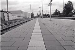 0009 (coloredsteel) Tags: street leica white black self 35mm graffiti stand kodak iso400 f14 trix rodinal developed m6 nokton trainspotting ulm voigtlnder developing trainwriting