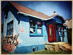 The Blue House  -51/100 (Firery Broome) Tags: door blue windows red usa house abandoned shop architecture graffiti cottage cellphone oldhouse delaware 365 newark textured phonephoto apps iphone ipad phoneography abandoneddelaware iphoneography fencefriday hipstamatic ipaddarkroom snapseed iphone5s janelens robustafilm distressedeffects image51100 100xthe2016edition 100x2016