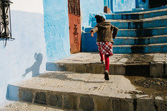 Chefchaouen, Morocco 2015 (f.d. walker) Tags: africa street city blue girls shadow people sun sunlight color colors girl kids stairs contrast children person kid hands fuji child hand candid steps colorphotography streetphotography fast streetportrait running morocco chefchaouen bluecity candidphotography