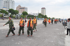Last search team (Roving I) Tags: news tourism army teams military events police vietnam camouflage uniforms lifejackets danang disasters tragedies tourboats lifepreservers searchers