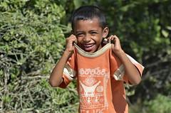 The Book of Life (Jos MF Azevedo) Tags: east timor leste bj sorriso smile te rosto face criana child book life o livro da vida manolo creep desajustado weirdo esquisito nikon d7000