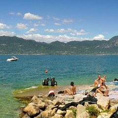 Lake Garda has always been appealing to divers and sunbathers (Bn) Tags: torri del benato lake garda sunbathing sunbather scuba diving gardameer lakegarda air water mountains mediterranean climate clouds fjord shape majestic landscape italy italia rock summer holiday vacation colour sport fun sailing coast carved kitesurfing windsurfing waves wind relaxation altogarda bresciano park unique discover gem largestlake turbulence weather blue sky swimming snorkeling clear dive freshwater warship divers 50faves topf50