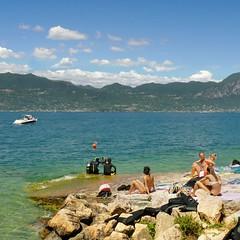 Lake Garda has always been appealing to divers and sunbathers (Bn) Tags: torri del benaco lake garda sunbathing sunbather scuba diving gardameer lakegarda air water mountains mediterranean climate clouds f