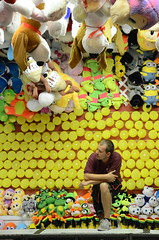 Revere Beach Carnival, 2013 (Rob Bellinger) Tags: new carnival summer england usa beach animals yellow boston night stuffed waiting american worker ballons revere carnie 2013