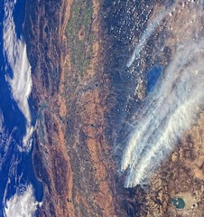 Rim and American Fires from ISS (sjrankin) Tags: california northerncalifornia clouds haze edited smoke nevada nasa pacificocean pollution yosemite cascades yosemitenationalpark monolake sierranevada westcoast iss centralvalley greatbasin rimfire coastrange smokeplume americanfire westcoastunitedstates iss036 1september2013 iss036e37187