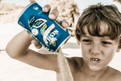 Not In My Drink (lothar1908) Tags: 50mm 5dmarkiii baleari bambino beach canon child drink estate esterno faccia face fingers formentera guido isola primopiano puntodivista ritratto sabbia sand scia sguardo lattina nestea blu blue bokeh sepia matchpointwinner mpt438