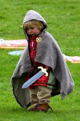 IMG_9981 (smiscandlon) Tags: colour english heritage face toy costume kid child sad little roman event sword warrior hobbit reenactment romans corbridge gladiators