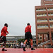 NC State student wrestlers warm up before beginnig practice on the brickyard Tuesday.