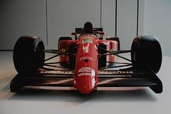 IMG_3746 (AndyLincolnEstonia) Tags: nyc red art car museum modern racecar 1 wings suspension manhattan wheels ferrari formula 1990 tyres