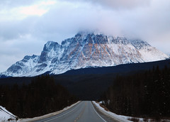 Rocky Mountains of Canada - entering Jasper National Park (vibrant_art) Tags: road travel snow canada mountains rockies jasper roadtrip alberta windshield canadianrockymountains