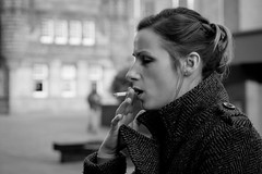 Out Through The Nose And In Through The Mouth (Leanne Boulton) Tags: life street city winter light portrait people urban blackandwhite bw woman white black cold girl monochrome beautiful beauty field weather contrast canon drag mono scotland blackwhite high aperture focus warm pretty break dof shot bokeh glasgow cigarette candid smoke coat profile working young pedestrian scene lips smoking human shade portraiture area draw brunette collar bandw smoker depth zone inhale vision:mountain=0617 vision:sky=0543 vision:outdoor=0763