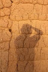 Self-portrait with mudbrick wall (10b travelling / Carsten ten Brink) Tags: africa selfportrait african westafrica afrika government junta burkina burkinafaso coup afrique selfie coupdetat 10b sankara lobi 2011 interim hautevolta gaoua burkinabe uppervolta compaore carstentenbrink blaisecompaore thomassankara